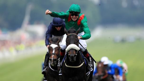 Harzand ridden by jockey Pat Smullen wins the Investec Derby