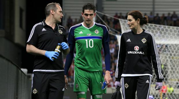 An injury to Kyle Lafferty, centre, is not believed to be serious