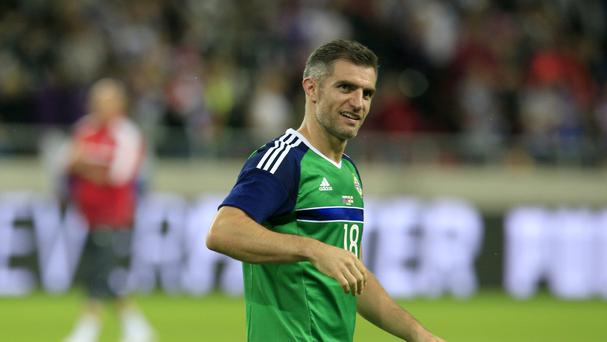Aaron Hughes earned his 100th cap against the country he made his debut against