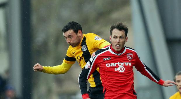Ireland's Jamie Devitt, right, has joined Carlisle on a two-year deal