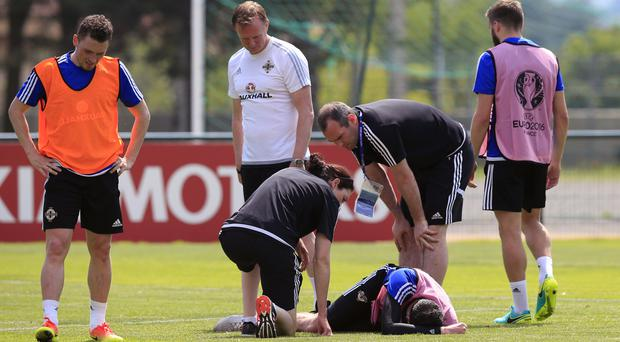 Kyle Lafferty, bottom right, was injured during training on Tuesday