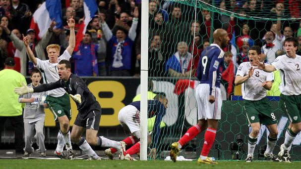 Thierry Henry, background, broke Irish hearts on their last visit to the Stade de France