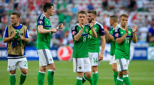 Steven Davis, centre, has called on Northern Ireland to remember that they are in France for a reason