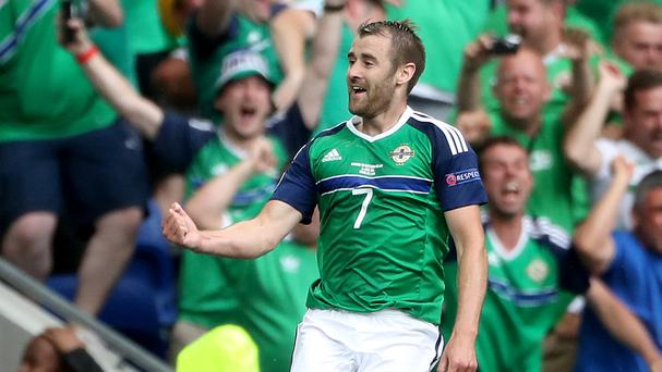 Niall McGinn jumps for joy after scoring Northern Ireland's second goal
