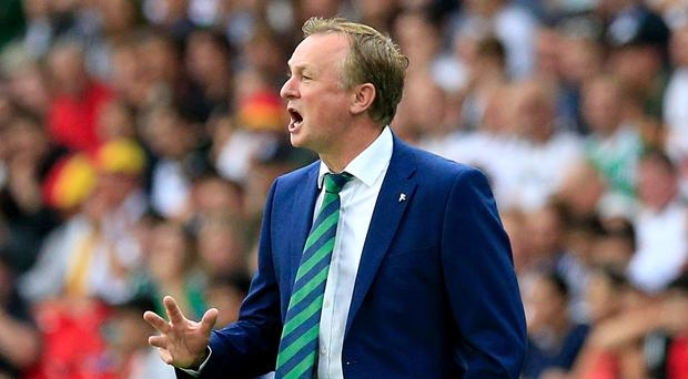Michael O'Neill's Northern Ireland are through to the last 16