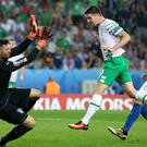 Robbie Brady heads the Republic of Ireland into the last 16