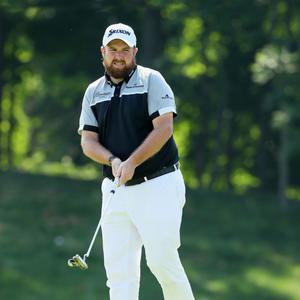 Shane Lowry of Ireland watches a putt on the sixth green during the final round of the U.S. Open at Oakmont Country Club.