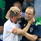 Republic of Ireland assistant manager Roy Keane (left) has vowed to carry on hugging