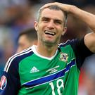 Northern Ireland's Aaron Hughes is not hanging up his boots just yet