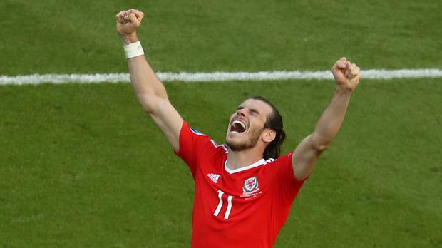 Gareth Bale celebrates following Wales' 1-0 win over Northern Ireland. Picture credit: PA News