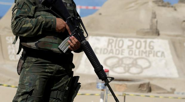 Beefing up: One of the 22,000 soldiers who arrived in Rio last week
