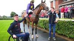 Trainer Robbie McNamara (left)