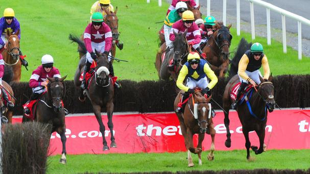 Lord Scoundrel and Donagh Meyler (maroon with a green cap centre) jump the last to win the Tote Galway Plate