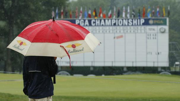 Persistent heavy rain left parts of the Baltusrol course flooded before play was abandoned for the day shortly before 6pm local time (AP)