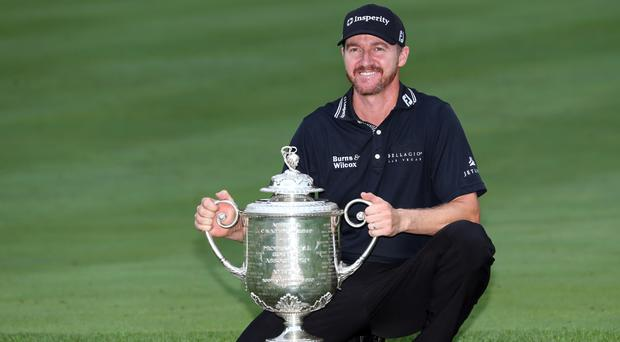 Jimmy Walker poses with the trophy after winning the US PGA Championship (AP)
