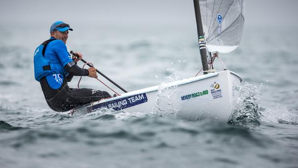 Team GBR Olympic sailor Giles Scott pictured racing his Finn class dinghy on day two of the ISAF Sailing World Cup at the Weymouth and Portland National Sailing Academy, Weymouth.