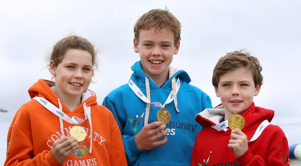 Olwyn Cooke (13) pictured with her brothers Uiseann (14) and Aonghus (11) after they all won gold medals in the Community Games swimming competitions.
