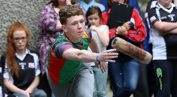 Jake Hickey from Hacketstown Co Carlow throws the skittle during the U16 final.