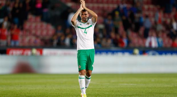 Gareth McAuley has urged Northern Ireland to take care of business against San Marino