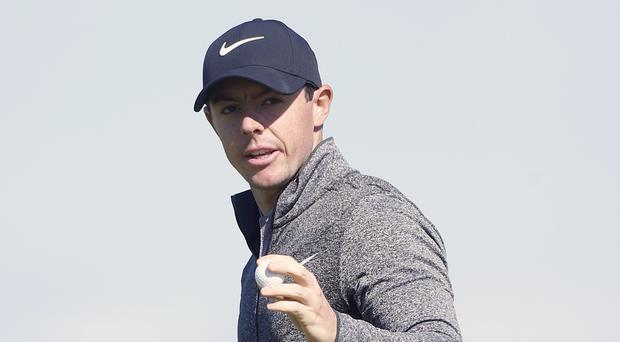 Rory McIlroy, pictured, is only two shots behind Tour Championship leader Dustin Johnson ahead of the final round