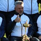 Rory McIlroy, right, is desperate to win the Ryder Cup for captain Darren Clarke