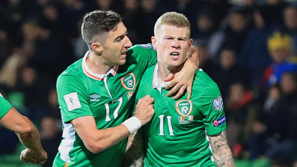 James McClean, right, celebrates with Stephen Ward