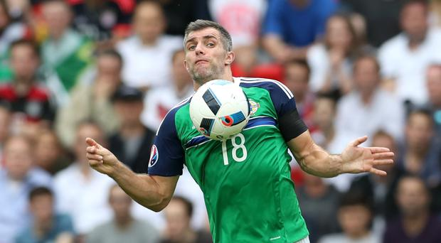 Aaron Hughes was restored to Northern Ireland's XI