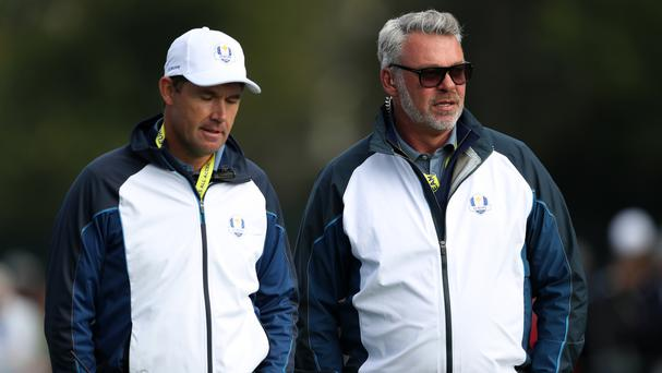 Padraig Harrington, left, does not want to succeed Darren Clarke as Europe's Ryder Cup captain