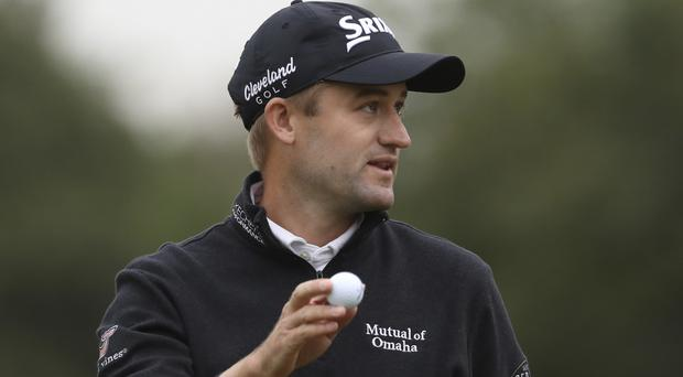Defending champion Russell Knox is three shots off the lead in Shanghai (AP)