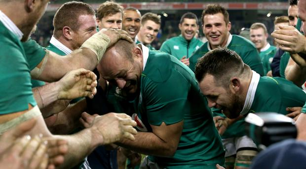 Ireland's captain Rory Best celebrates with team-mates after beating Australia