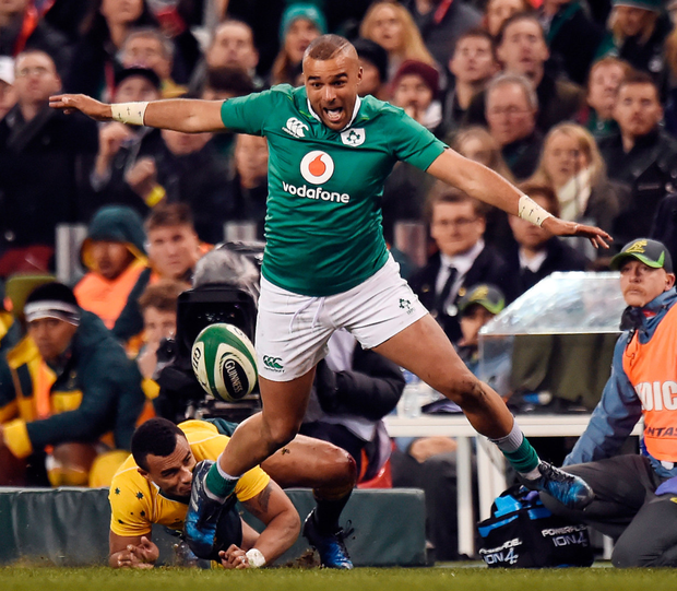 Simon Zebo is tackled by Australia's Will Genia during Ireland's victory. Photo: Sportsfile