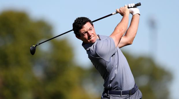 Rory McIlroy continues to battle a rib injury