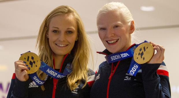 Kelly Gallagher, right, won gold at Sochi 2014 with guide Charlotte Evans