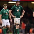 Ireland players look dejected after the RBS Six Nations loss to Wales
