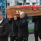 Ryan McBride's coffin was carried to his home on Wednesday