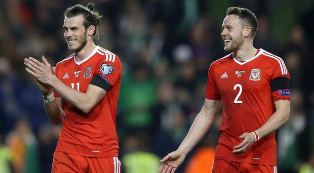 Chris Gunter, right, believes Wales will prove they are not a one-man band when they attempt to keep their World Cup qualification hopes alive without Gareth Bale