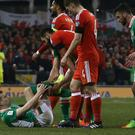 Republic of Ireland defender Seamus Coleman holds his leg after a challenge from Wales' Neil Taylor on Friday.