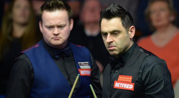 Ronnie O'Sullivan, pictured right, leads Shaun Murphy 10-6 overnight