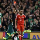 Wales defender Neil Taylor will serve a two-game suspension for his World Cup dismissal in Dublin