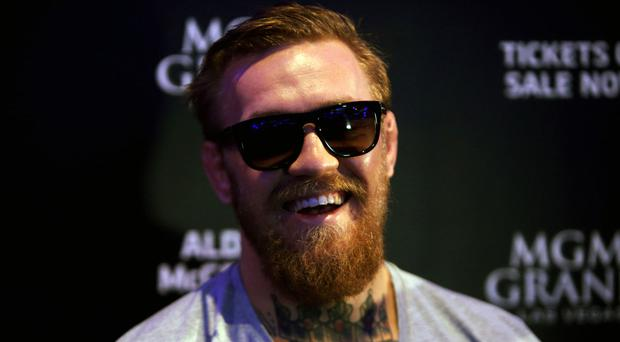 Conor McGregor claims he has signed a deal to fight Floyd Mayweather in a boxing match