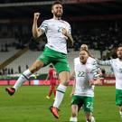 Daryl Murphy, left, celebrates scoring in Serbia