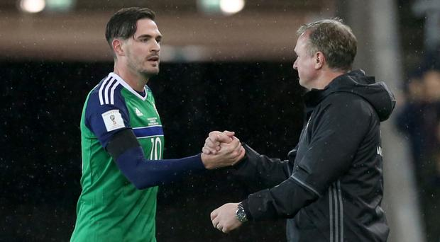 Michael O'Neill, right, has managed to get the best out of Kyle Lafferty