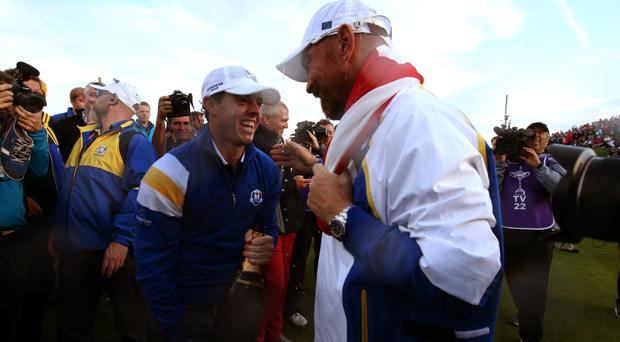 Rory McIlroy (left) can contend for a second US Open title, according to former Ryder Cup team-mate Thomas Bjorn (right)