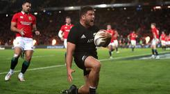 Codie Taylor celebrates scoring New Zealand's opening try