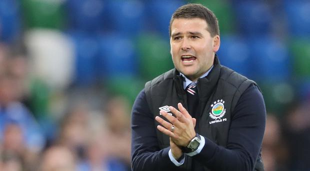 David Healy's Linfield side progressed to a Champions League second qualifying round tie against Scottish giants Celtic