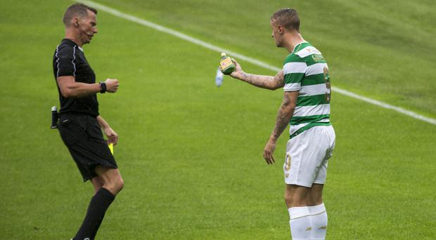 Leigh Griffiths, right, showed the referee an object that was thrown onto the pitch against Linfield
