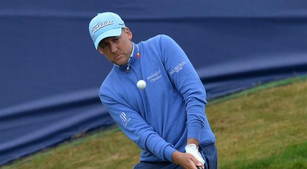 Without a win since 2012, Ian Poulter will take a share of the lead into Sunday's final round