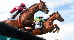 Barry Geraghty and eventual winner Housesofparliament (right) jump the fifth with Cinema De Quartier on the way to landing the Colm Quinn BMW Novice Hurdle. Photo: Sportsfile