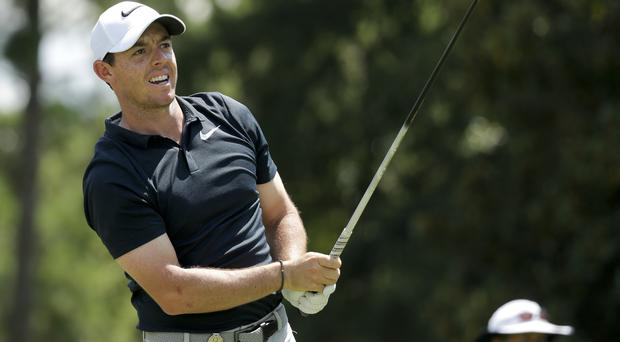 Rory McIlroy is five shots off the lead (AP)