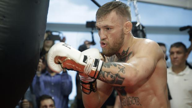 Conor McGregor is preparing to fight on August 26 (AP)